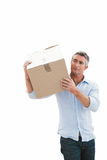 Cheerful man carrying cardboard box Stock Photography