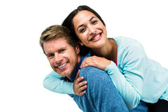 Cheerful man carrying girlfriend on back Royalty Free Stock Images