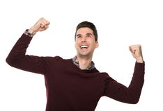 Cheerful man celebrating with arms raised Stock Photography