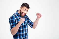 Cheerful man celebrating his success Royalty Free Stock Image
