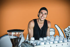 Cheerful man at coffee making machine Royalty Free Stock Photography