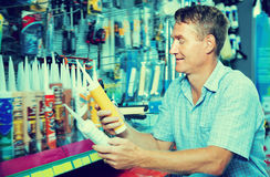 Cheerful man customer picking sealing component Stock Photo
