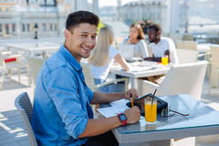 Cheerful man doing business work outdoors Stock Photo