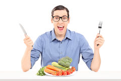 Cheerful man eating a bunch of vegetables Royalty Free Stock Images