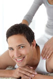 Cheerful man enjoying a back massage from his wife Stock Photo