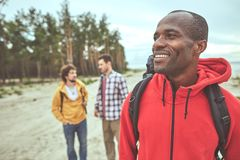 Cheerful man enjoying his journey with friends stock images