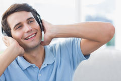 Cheerful man enjoying music Royalty Free Stock Images
