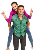 Cheerful man giving piggy back to his girlfriend Royalty Free Stock Images