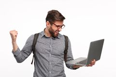 Cheerful man happy with news in laptop Stock Photo