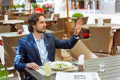 Cheerful man having breakfast in cafe Royalty Free Stock Images