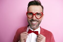 Happy man wearing funny glasses royalty free stock photography