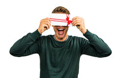 Cheerful man hiding face with gift Stock Photos