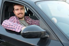 Portrait of young male driver at the wheel Royalty Free Stock Images