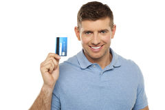Cheerful man holding credit card Stock Images