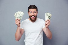 Cheerful man holding dollar bills Royalty Free Stock Photography