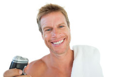Cheerful man holding an electric razor Royalty Free Stock Photo