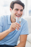 Cheerful man holding a glass of water Royalty Free Stock Photo