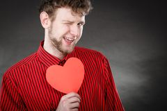 Cheerful man holding heart. Royalty Free Stock Image