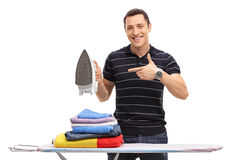 Cheerful man holding an iron Royalty Free Stock Photography