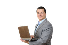 Cheerful man holding laptop Royalty Free Stock Images
