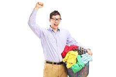 Cheerful man holding a laundry basket Royalty Free Stock Photos