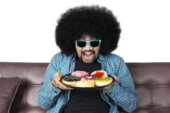 Cheerful man holding a plate of donuts Stock Photo