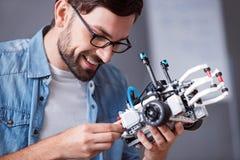 Cheerful man holding robot Stock Image