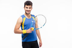 Cheerful man holding tennis racket and ball Stock Photo