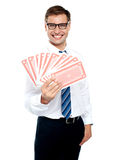 Cheerful man holding up playing cards Stock Photography
