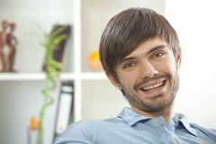 Cheerful man at home Stock Images
