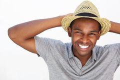 Cheerful man laughing with hands behind head Stock Image