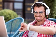 Cheerful man listening to music Royalty Free Stock Image