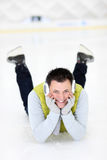 Cheerful man lying on a skating rink Stock Photography
