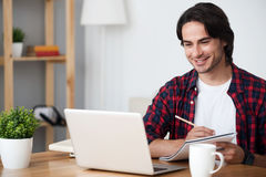 Cheerful man making notes Stock Photography