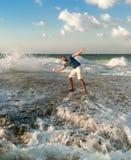 Cheerful man near mediterranean sea. At sunset Royalty Free Stock Images