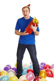 Cheerful man with New Year's gift in hands Royalty Free Stock Photos
