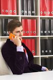 Cheerful man in office talking the phone Royalty Free Stock Photo