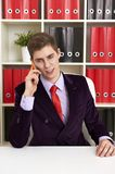 Cheerful man in office talking the phone Royalty Free Stock Image