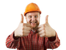 Cheerful man in an orange construction helmet Stock Photography