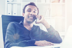 Cheerful man on phone in office Stock Photography