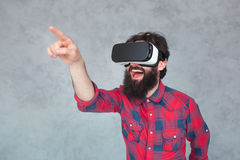 Cheerful man pointing air in VR helmet Royalty Free Stock Photography