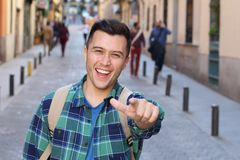 Cheerful man pointing at camera outdoors stock images
