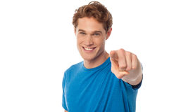 Cheerful man pointing towards camera Royalty Free Stock Image