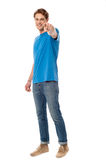 Cheerful man pointing towards camera Royalty Free Stock Photos