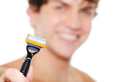Cheerful man with razor on the foreground. Portrait of  laughing cheerful man with razor on the foreground Royalty Free Stock Images