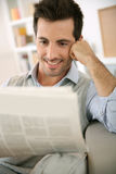 Cheerful man reading good news on paper Royalty Free Stock Photo