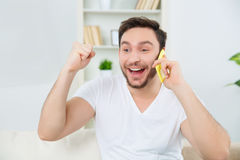 Cheerful man is ready to celebrate the good news. Royalty Free Stock Image
