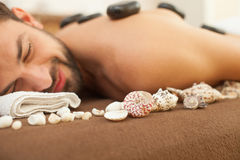 Cheerful man is relaxing at beauty salon Stock Image