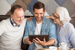 Cheerful man resting in the cafe with his grandparents Stock Photography
