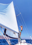 Cheerful man on sailboat Stock Image